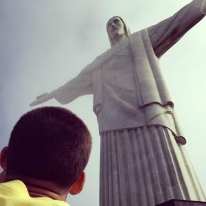 Pilgrim contemplating Christ the Redeemer Statue.